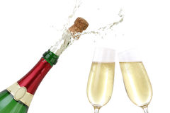 Champagne splashing out of the bottle. With a popping cork royalty free stock photography