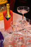 Champagne and stack of glasses for celebration Royalty Free Stock Photo