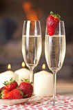 Champagne and strawberries. Champagne, strawberries and candles for a romantic evening Stock Photo