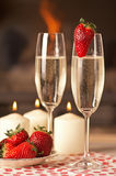 Champagne and strawberries. Champagne, strawberries and candles for a romantic evening Royalty Free Stock Photo