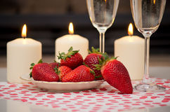 Champagne, strawberries and candles. Stock Photo