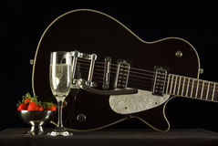 Champagne, Strawberries, and a Guitar Stock Photo