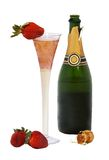 Champagne with strawberries - isolated on white. Open bottle of champagne with cork, glass filed with wine and fresh strawberries isolated on white Royalty Free Stock Image
