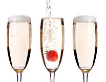 Champagne with strawberry - christmas cocktail Stock Photos