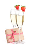 Champagne with strawberry and gift box Royalty Free Stock Images