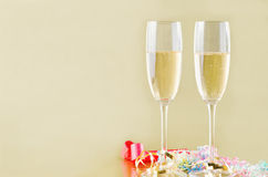 Champagne and Streamers on Gold Royalty Free Stock Photos