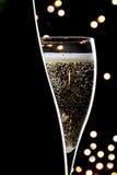 Champagne su priorità bassa nera Fotografia Stock Libera da Diritti