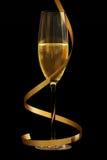 Champagne sur le noir Photographie stock libre de droits