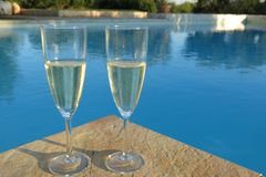 Champagne by the swimming pool Stock Image