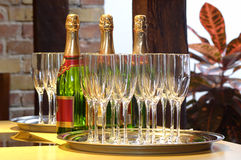 Champagne for three. Lot of clean champagne glasses and three bottles waiting to be opened at a party Royalty Free Stock Photos