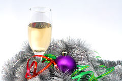 Champagne among the tinsel. Champagne among the tinsel and Christmas toys Stock Images