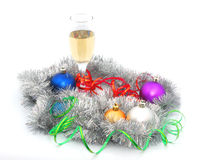 Champagne among the tinsel. Champagne among the tinsel and Christmas toys Stock Photography