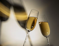 Champagne Toast 3. Champagne toast.  Glasses cast a distinctive shadow with a rainbow of golden light reflected in the shadows Royalty Free Stock Images