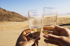 Champagne toast. Party in the desert royalty free stock images