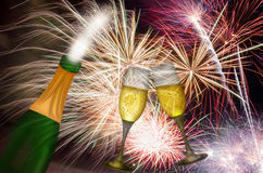 Champagne Toast with Fireworks Background. Champagne Bottle and Two Flutes Toasting with Fireworks Background Royalty Free Stock Photography