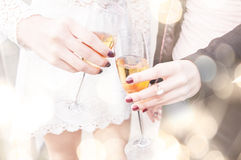 Champagne toast. Two young woman celebrating with champagne.Close-up Royalty Free Stock Images