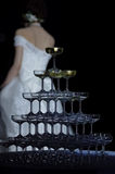 Champagne tower. With bride in the background Royalty Free Stock Photo