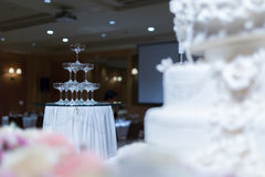 Champagne tower and wedding cake in front of. stock photography