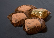 Champagne Truffles. Luxury fair trade Champagne chocolate Truffles, dusted with cocoa powder on dark slate background Royalty Free Stock Photography