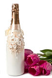 Champagne and tulips Stock Photos