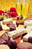 Champagne and turron, mantecados and polvorones, typical christm Royalty Free Stock Images