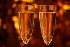 Champagne twee glazengoud bokeh Stock Fotografie