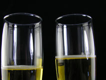 Champagne for two. Champagne glasses on a black background royalty free stock image