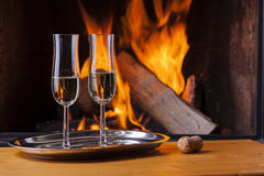 Champagne for two at cozy fireplace Stock Photos