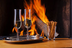 Champagne for two at cozy fireplace Royalty Free Stock Images