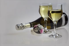 Champagne for two. Description: Image of two glasses and one bottle Champagne on a grey background Royalty Free Stock Images