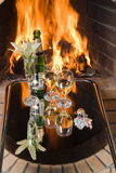 Champagne for a two at a fireplace. Stock Photos