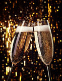 Champagne. Two flutes of champagne on bokeh background Royalty Free Stock Photography
