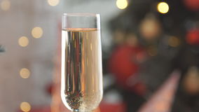Champagne. Two Flutes with Sparkling Champagne over Christmas Holiday Bokeh Blinking Background. Champagne. Two Flutes with Sparkling Champagne over Christmas stock footage