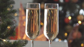 Champagne. Two Flutes with Sparkling Champagne over Holiday Bokeh Blinking Background. stock video footage