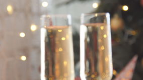 Champagne. Two Flutes with Sparkling Champagne over Holiday Bokeh Blinking Background.  stock video