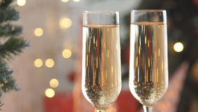 Champagne. Two Flutes with Sparkling Champagne over Holiday Bokeh Blinking Background stock footage