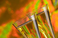 Champagne. Two glasses of champagne with a colorful background Royalty Free Stock Photos