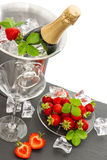 Champagne, two glasses and strawberries Royalty Free Stock Photos
