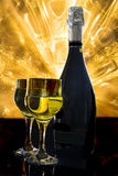 Champagne for two. Image of two glasses and one bottle Champagne on a bright abstract background Stock Photography
