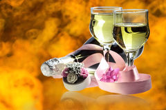 Champagne for two. Image of two glasses and one bottle Champagne on a bright abstract background Royalty Free Stock Photos