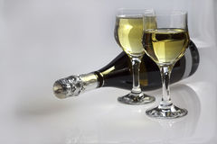 Champagne for two. Image of two glasses and one bottle Champagne on a grey background Royalty Free Stock Image