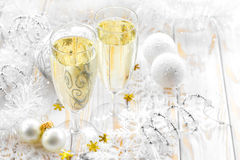Champagne. In a two wineglasses on a table and christmas decorations Royalty Free Stock Image
