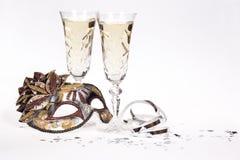 Champagne- und Maskerademaske Lizenzfreies Stockfoto