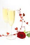 Champagne und Rot stiegen. Lizenzfreies Stockfoto