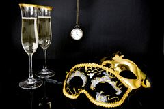 Champagne, Venetian masks and watch Royalty Free Stock Image