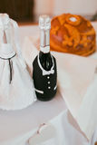 Champagne wedding bottles in suit festive decoration Stock Image