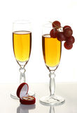 Champagne and wedding rings Stock Image