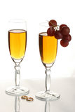 Champagne and wedding rings stock photo