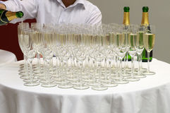 Champagne welcome for guests. The waiter pours champagne into the glasses Stock Photography
