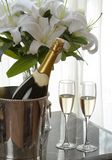 Champagne and white lily. Champagne cups and white lily Stock Image
